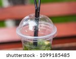 a cup of mojito stands on the... | Shutterstock . vector #1099185485
