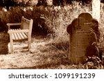 wooden bench and gravestones... | Shutterstock . vector #1099191239