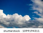 white clouds against the blue...   Shutterstock . vector #1099194311