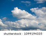 white clouds against the blue...   Shutterstock . vector #1099194335