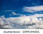 white clouds against the blue...   Shutterstock . vector #1099194401