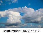 white clouds against the blue...   Shutterstock . vector #1099194419