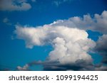 white clouds against the blue...   Shutterstock . vector #1099194425