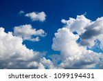 white clouds against the blue...   Shutterstock . vector #1099194431