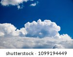 white clouds against the blue...   Shutterstock . vector #1099194449