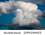white clouds against the blue...   Shutterstock . vector #1099194455