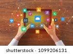 hand touching multitask tablet... | Shutterstock . vector #1099206131