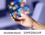 hand using phone with colorful... | Shutterstock . vector #1099206149