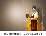 manual worker with wrench... | Shutterstock . vector #1099210535