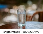 glass of water on the table | Shutterstock . vector #1099220999