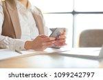 female manager holding... | Shutterstock . vector #1099242797