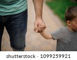 strong father hand holding a... | Shutterstock . vector #1099259921