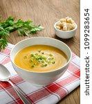 pumpkin carrot soup with herbs... | Shutterstock . vector #1099283654