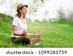 listening to guided meditation... | Shutterstock . vector #1099283759