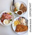 fish steak with vegetables ... | Shutterstock . vector #1099287497