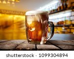 a big glass of beer on counter... | Shutterstock . vector #1099304894