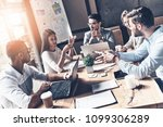 team at work. top view of young ... | Shutterstock . vector #1099306289