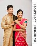 attractive happy north indian...   Shutterstock . vector #1099329089