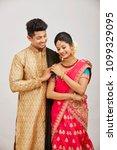 attractive happy north indian...   Shutterstock . vector #1099329095