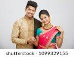 attractive happy north indian...   Shutterstock . vector #1099329155