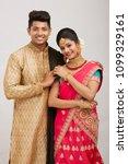 attractive happy north indian... | Shutterstock . vector #1099329161