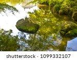 sunlight reflecting  water in... | Shutterstock . vector #1099332107