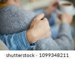 hand of senior man on his wife... | Shutterstock . vector #1099348211