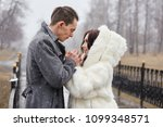 couple in love hugs and kisses... | Shutterstock . vector #1099348571