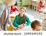diligent schoolgirl in green... | Shutterstock . vector #1099349195
