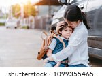 mother soothe a son crying and... | Shutterstock . vector #1099355465