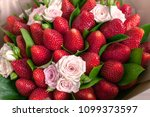 Stock photo delicious bouquet of strawberries and roses close up 1099373597