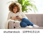 portrait of young african woman ... | Shutterstock . vector #1099415114