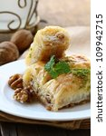 Turkish arabic dessert - baklava with honey and nuts - stock photo
