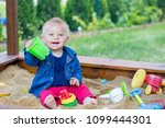 little baby boy  playing in a... | Shutterstock . vector #1099444301