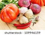 American ribbed tomatoes with spices, vegetable still life - stock photo