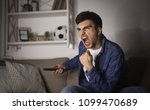 excited man watching football... | Shutterstock . vector #1099470689
