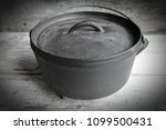 cast iron dutch oven on wooden... | Shutterstock . vector #1099500431