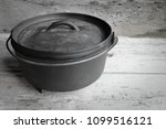 cast iron dutch oven with old... | Shutterstock . vector #1099516121
