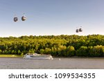tourist boat floats along the...   Shutterstock . vector #1099534355