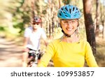 couple on bikes in the sunny...   Shutterstock . vector #109953857
