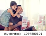 Happy Father's Day Concept. Child Daughter Hiding Surprise Postcard Present for Her Dad. - stock photo