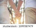 lover catching hands together... | Shutterstock . vector #1099587479