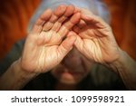 old woman afraid | Shutterstock . vector #1099598921