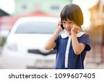 Asian Cute Kid Holding...
