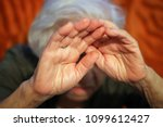 old woman afraid | Shutterstock . vector #1099612427