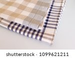 two kitchen towels are beige... | Shutterstock . vector #1099621211