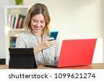 happy female using multiple... | Shutterstock . vector #1099621274