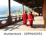 Two Young Monks Walking On ...
