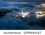 civil passenger plane in flight.... | Shutterstock . vector #1099644167
