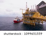 supply boat transfer cargo to... | Shutterstock . vector #1099651559